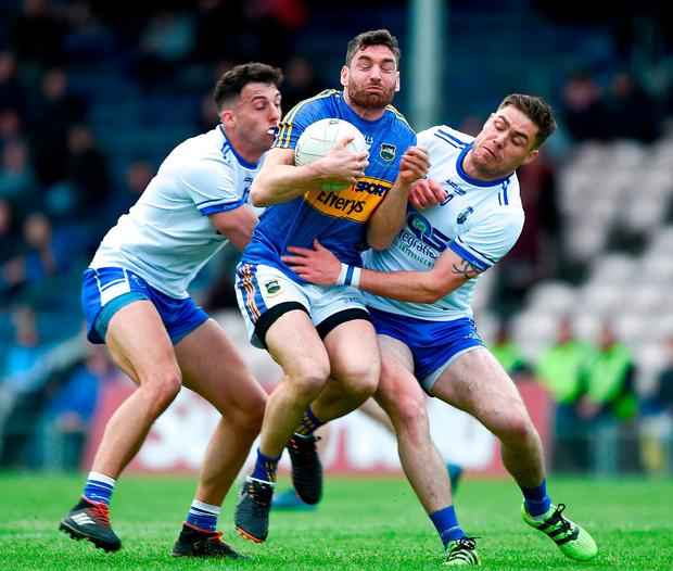 Tipperary's Philip Austin feels the squeeze as he's tackled by Waterford duo Shane Ryan (L) and Craig Guiry. Photo by Daire Brennan/Sportsfile