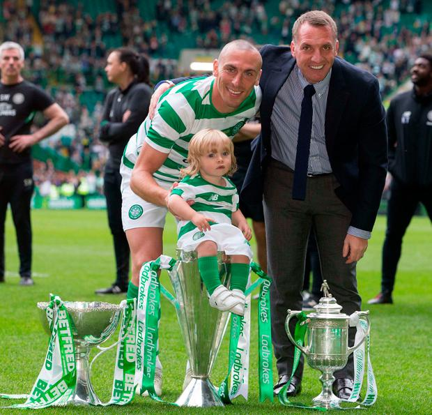Celtic's Scott Brown with manager Brendan Rodgers and his daughter during the testimonial match at Celtic Park. Photo: Jeff Holmes/PA