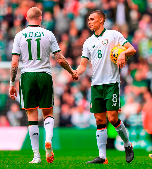 Ireland's Graham Burke, 8, and James McClean shake hands following Scott Brown's testimonial match. Photo: Stephen McCarthy/Sportsfile