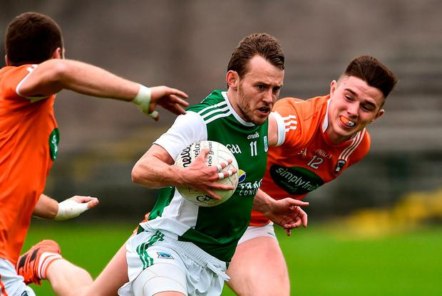 Declan McCusker of Fermanagh in action against Brendan Donaghy, left, and Ben Crealey of Armagh. Photo by Oliver McVeigh/Sportsfile