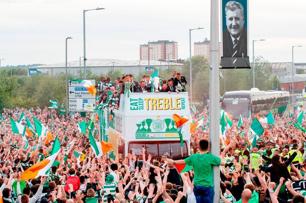 Fans engulf the Celtic team bus during the parade at Celtic Park. Photo: Jeff Holmes/PA