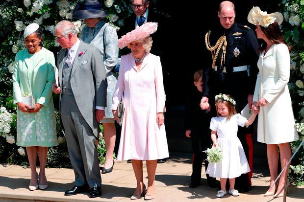 Mother of the bride Doria Ragland, the Prince of Wales, the Duchess of Cornwall, the Duke and Duchess of Cambridge with Prince George and Princess Charlotte leave St George's Chapel in Windsor Castle after the wedding. Photo: Andrew Matthews/PA