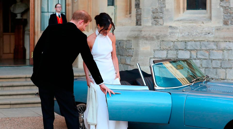 The newly married Duke and Duchess of Sussex, Meghan Markle and Prince Harry, leaving Windsor Castle after their wedding to attend an evening reception at Frogmore House. Photo: Steve Parsons/PA Wire