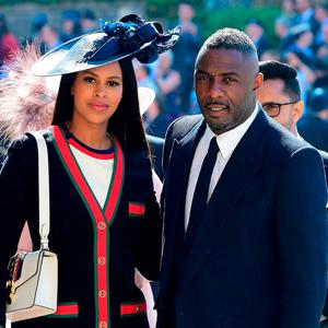 Idris Elba and Sabrina Dhowre arrive at St George's Chapel on Saturday. Photo: Getty Images