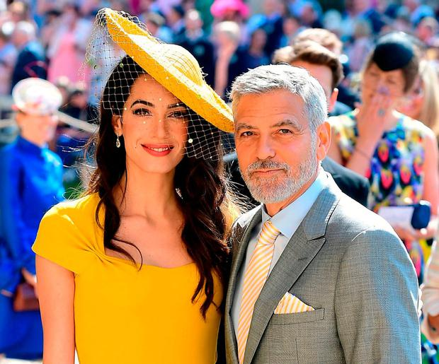 Amal and George Clooney arrive at St George's Chapel at Windsor Castle before the wedding. Photo: Getty Images