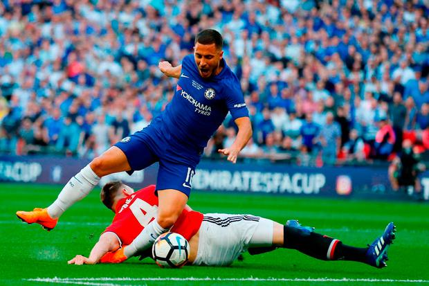 Eden Hazard is taken down by Phil Jones for the decisive penalty kick at Wembley. Photo: Getty Images