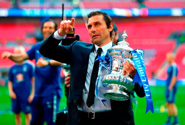 Holding the cup offers little cheer for Antonio Conte. Photo: Getty Images