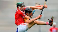 Cork's Mark Coleman gets a foot up on Clare's Cathal Malone during yesterday's Munster SHC clash. Photo by Brendan Moran/Sportsfile