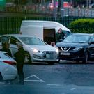 The black Nissan Qashqai driven by Mark Hennessy is surrounded by unmarked garda vehicles after he was spotted in Cherrywood and shot by armed officers. Photo: Arthur Carron