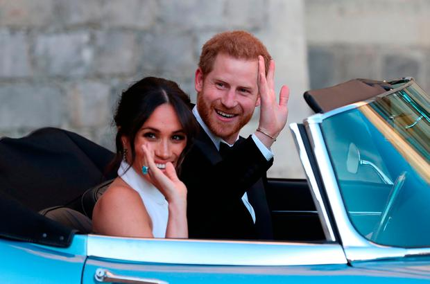 Prince Harry, Duke of Sussex, (R) and Meghan Markle, Duchess of Sussex, (L) leave Windsor Castle after their wedding to attend an evening reception at Frogmore House. Photo: AFP/Getty Images