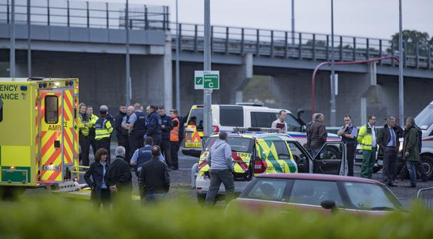 Emergency services at the scene of the shooting yesterday.