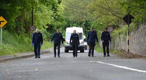 Gardai searching for clues in relation to Jastine Valdez's abduction yesterday.