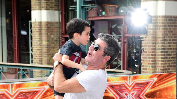 Simon Cowell and son Eric (Ian West/PA)