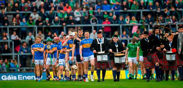 The Tipperary and Limerick teams on parade prior to the Munster GAA Hurling Senior Championship Round 1 match between Limerick and Tipperary at the Gaelic Grounds in Limerick. Photo by Ray McManus/Sportsfile