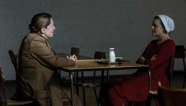 Ann Dowd and Elizabeth Moss as Aunt Lydia and Offred in The Handmaid's Tale