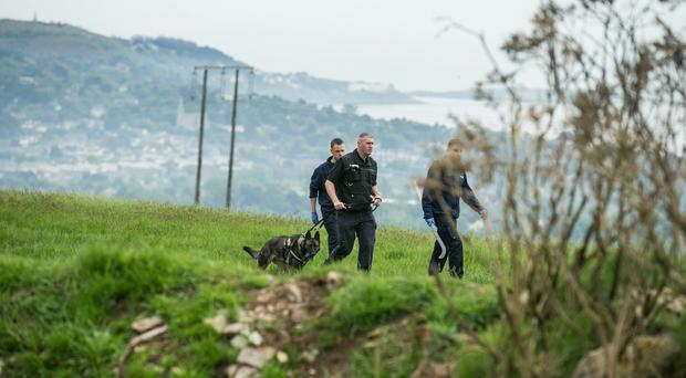 Gardai searching at the top of Rathmichael at Kathy Gallaghers Lead Mines