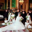 NEWS EDITORIAL USE ONLY. NO COMMERCIAL USE. NO MERCHANDISING, ADVERTISING, SOUVENIRS, MEMORABILIA or COLOURABLY SIMILAR. NOT FOR USE AFTER 31 DECEMBER 2018 WITHOUT PRIOR PERMISSION FROM KENSINGTON PALACE. NO CROPPING. Copyright in the photograph is vested in The Duke and Duchess of Sussex. Publications are asked to credit the photograph to Alexi Lubomirski. No charge should be made for the supply, release or publication of the photograph. The photograph must not be digitally enhanced, manipulated or modified in any manner or form and must include all of the individuals in the photograph when published. This official wedding photograph released by the Duke and Duchess of Sussex shows The Duke and Duchess in The Green Drawing Room, Windsor Castle, with (left-to-right): Back row: Master Brian Mulroney, Miss Remi Litt, Miss Rylan Litt, Master Jasper Dyer, Prince George, Miss Ivy Mulroney, Master John Mulroney. Front row: Miss Zalie Warren, Princess Charlotte, Miss Florence van Cutsem. PRESS ASSOCIATION Photo. Picture date: Saturday May 19, 2018. See PA story ROYAL Wedding. Photo credit should read: Alexi Lubomirski/PA Wire