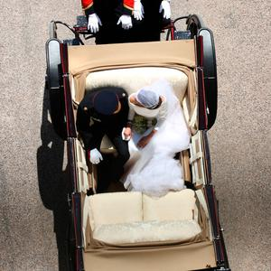 Prince Harry and Meghan Markle ride in an Ascot Landau along the Long Walk after their wedding in St George's Chapel in Windsor Castle Windsor, Britain, May 19, 2018. Yui Mok/Pool via REUTERS