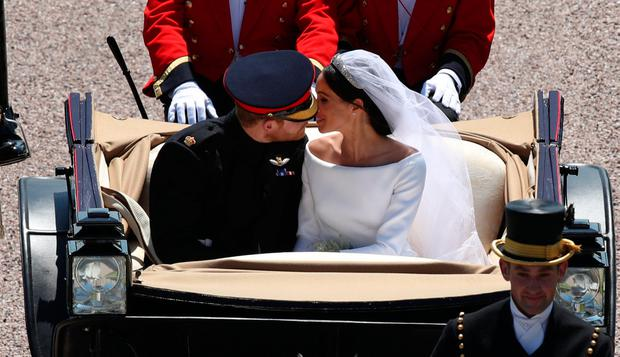 Prince Harry and Meghan Markle ride in an Ascot Landau along the Long Walk after their wedding in St George's Chapel in Windsor Castle in Windsor, Britain, May 19, 2018. Yui Mok/Pool via REUTERS