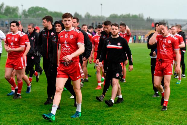 Cathal McShane (No. 10) leads a group of dejected Tyrone players off Healy Park after Sunday's Ulster SFC defeat to Monaghan. Photo: Oliver McVeigh/Sportsfile