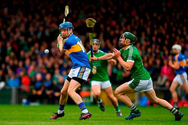 Limerick's Sean Finn dives in to block a shot by Tipperary's John McGrath during the Munster SHC clash at the Gaelic Grounds. Photo: Ray McManus/Sportsfile