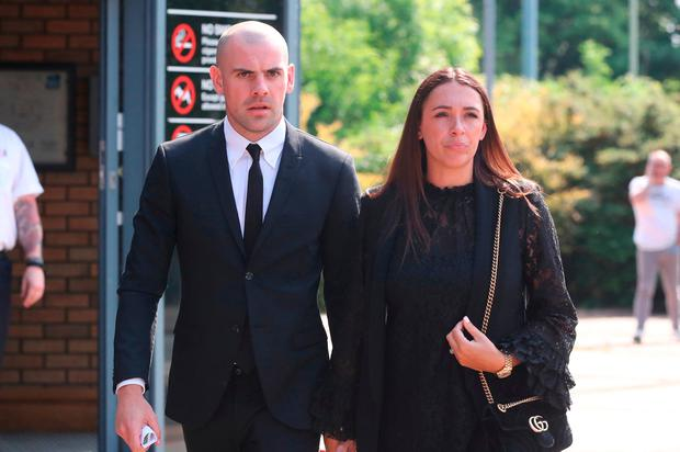 Darron Gibson leaves South Tyneside Magistrates' Court with his wife Danielle after the hearing