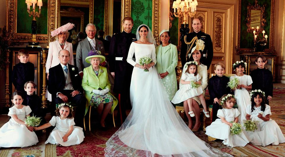 Harry and Meghan (centre) are pictured surrounded by beaming page boys and bridesmaids and (back row, left to right) Camilla, the Duchess of Cornwall; Prince Charles; Meghan's mother, Doria Ragland; Prince William; (middle row, left-right) Prince Philip; Queen Elizabeth II; Catherine, Duchess of Cambridge; Princess Charlotte and Prince George. Photo: Alexi Lubomirski/PA Wire