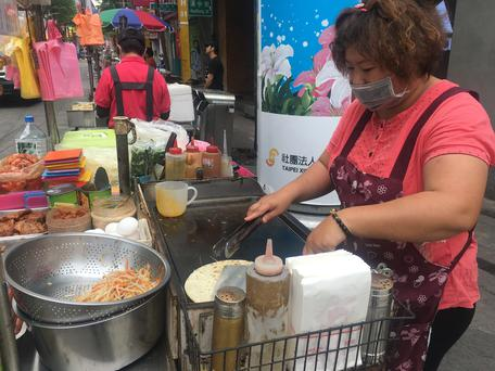 A street vendor in Taipei, Taiwan where urbanisation, rising incomes and concerns about health are driving a move towards more protein-rich alternatives to the staple food, rice. April 11, 2018. Thomson Reuters Foundation\\Rina Chandran