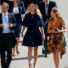 Chelsy Davy (C) arrives for the wedding ceremony of Britain's Prince Harry, Duke of Sussex and US actress Meghan Markle at St George's Chapel, Windsor Castle, in Windsor, on May 19, 2018. Odd ANDERSEN/Pool via REUTERS