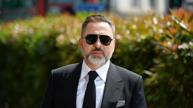 David Walliams arrives for the funeral of Dale Winton