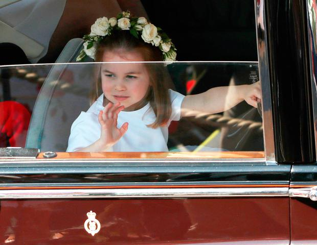 e09281de1c61 Princess Charlotte waves as she leaves St George s Chapel at Windsor Castle  following the wedding of