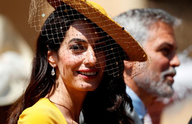 Amal Clooney and George Clooney arrive for the wedding ceremony of Prince Harry and Meghan Markle at St. George's Chapel in Windsor Castle in Windsor, Britain, May 19, 2018. Alastair Grant/Pool via REUTERS