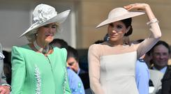 Meghan attends a garden party at Buckingham Palace, with Camilla the Duchess of Cornwall, in London, Britain May 22, 2018. Dominic Lipinski/Pool via Reuters