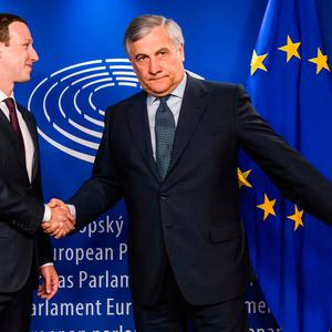 European Parliament President Antonio Tajani, right, welcomes Facebook CEO Mark Zuckerberg upon his arrival at the EU Parliament in Brussels on Tuesday, May 22, 2018. (AP Photo/Geert Vanden Wijngaert)
