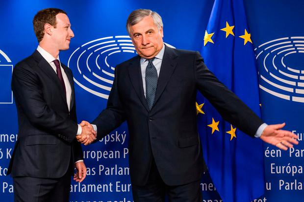 European Parliament President Antonio Tajani right welcomes Facebook CEO Mark Zuckerberg upon his arrival at the EU Parliament in Brussels on Tuesday