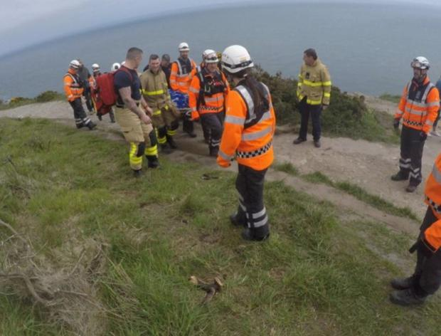 Members of the Irish Coast Guard and Dublin Fire Brigade on Howth Head