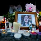 Candles and flowers surround a photograph of Jastine Valdez at a vigil in Enniskerry. Picture: Gerry Mooney