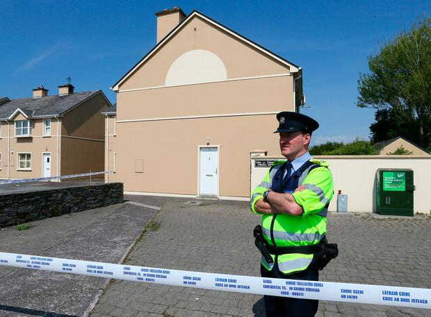 Garda pictured at the house on Fertha Drive in Caherciveen where Robert Elston was discovered after being stabbed.Picture:Frank Mc Grath