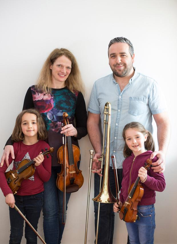 In tune: Mia Cooper, Paul Frost and their daughters Íde and Joanie.Photo: Mark Condren