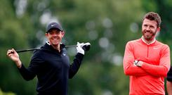 Manchester United supporter Rory McIlroy with Michael Carrick during the BMW PGA Championship pro-am at Wentworth. Photo: Reuters