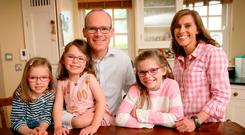Simon Coveney with his wife Ruth and their children Jessica (6), Annalise (4) and Beth (8) pictured at their home in Carragaline, Cork, last year during the Fine Gael leadership contest. Photo: Frank McGrath