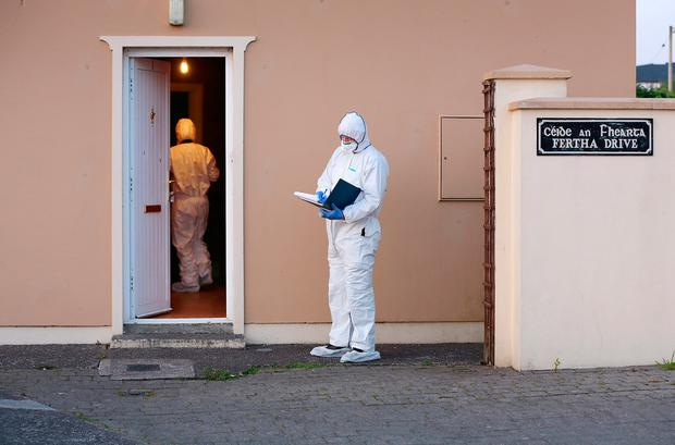 Garda forensics at the house on Fertha Drive in Cahersiveen where Robert Elston was discovered after being stabbed. Photo: Frank McGrath
