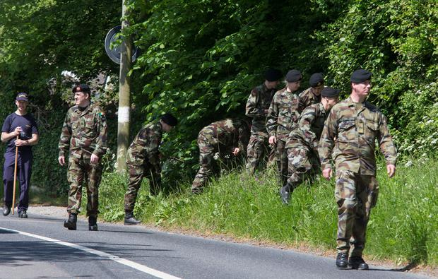 Members of the Defence Forces search for Jastine Valdez's handbag at Puck's Castle Lane yesterday. Photo: Colin O'Riordan