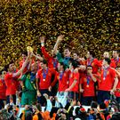 Spain's players hold the trophy during the award ceremony following the 2010 FIFA football World Cup between the Netherlands and Spain on July 11, 2010 at Soccer City stadium in Soweto, suburban Johannesburg. Spain won 1-0. AFP PHOTO / GABRIEL BOUYS