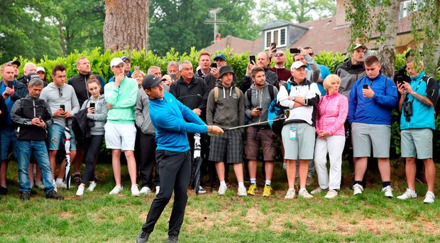 Rory McIlroy gets off to solid start at Wentworth despite photographer distraction on 18th hole