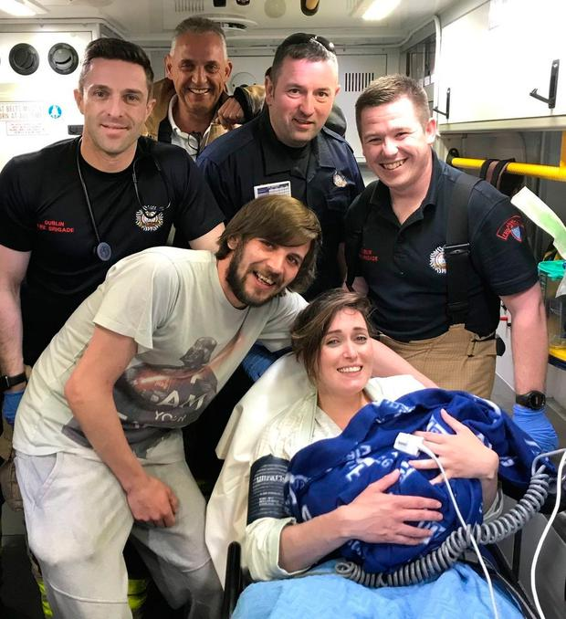 Darren and Jessica with baby Cooper and members of Donnybrook emergency services