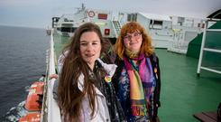 Emma O'Reilly and Orla Price on the ferry to Dublin from Holyhead yesterday to vote in the referendum today. Photo: Mark Condren