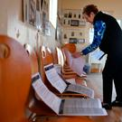 Presiding Officer Carmel McBride prepares the polling station for the referendum on liberalising abortion law a day early for the residents of Inishbofin, Ireland. Photo: Clodagh Kilcoyne/PA Wire