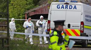 Gardai look for clues at the derelict farmhouse where her body was found. Photo: Colin Keegan/Collins Agency