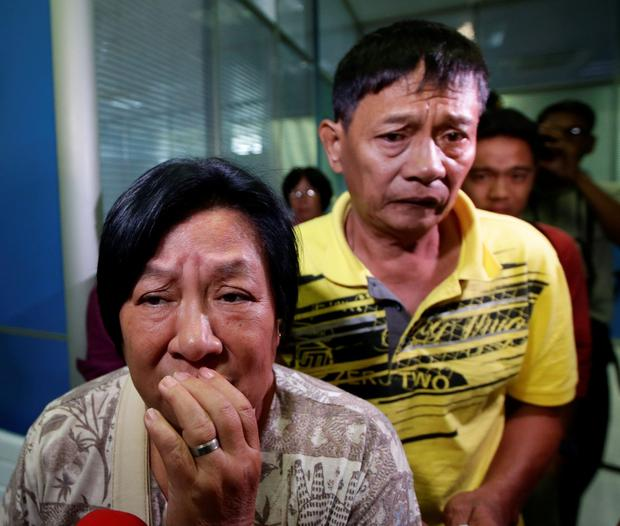Lenoir Linda and Tirso Pabellon, grieving relatives who lost their sister Irene Pabellon Gunawan in the catastrophe. Photo: Bullit Marquez